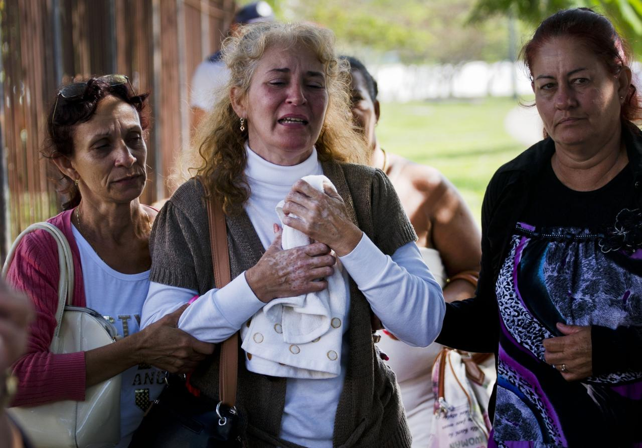 <p>Grieving relatives of passengers who perished in Cuba's worst aviation disaster leave the morgue, in Havana, Cuba, Saturday, May 19, 2018. (Photo: Ramon Espinosa/AP) </p>