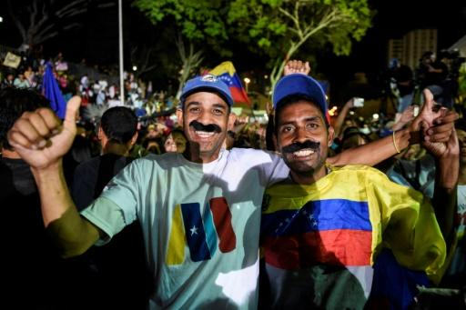 Supporters of the President Nicolas Maduro celebrate after the Venezuelan leader was officially declared the presidential election winner