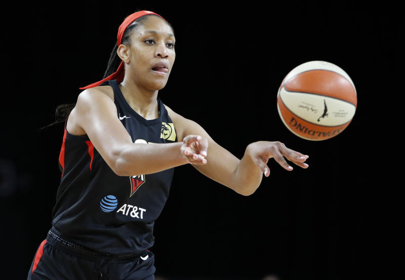 Las Vegas Aces' A'ja Wilson passes against the Washington Mystics during the first half of Game 4 of a WNBA playoff basketball series Tuesday, Sept. 24, 2019, in Las Vegas. (AP Photo/John Locher)