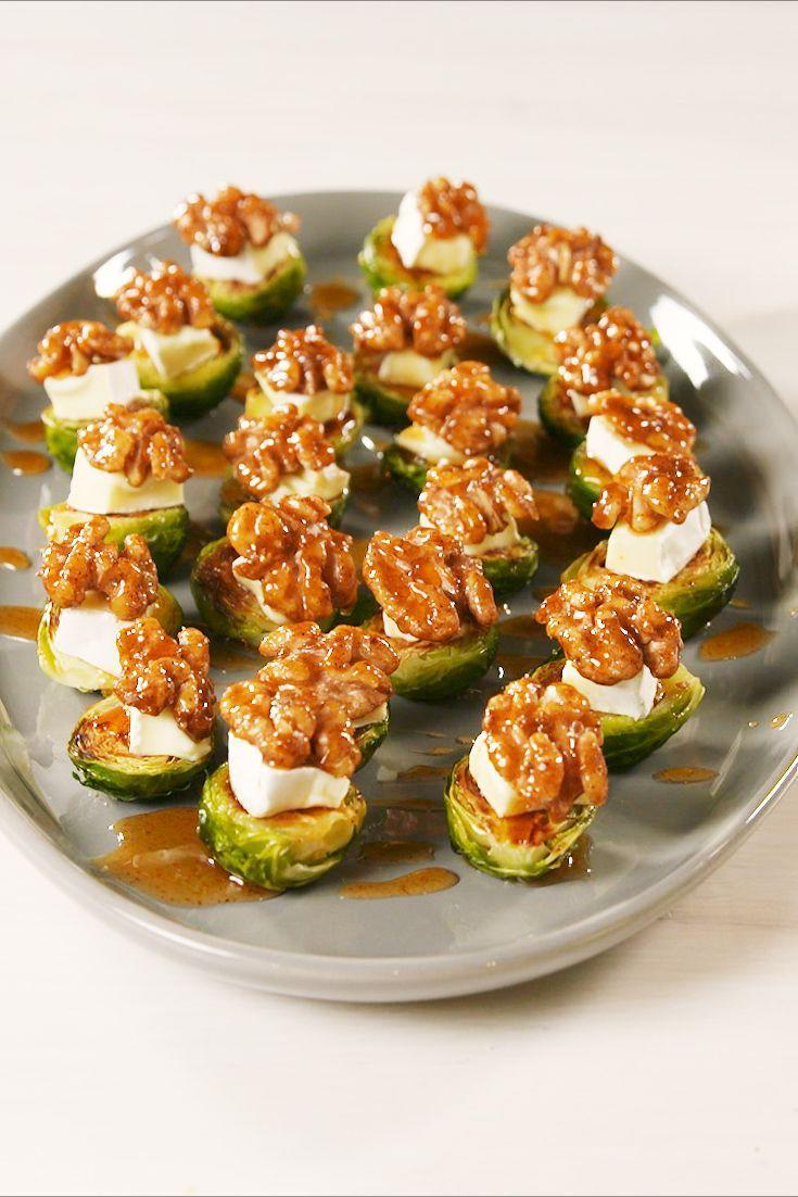 """<p>The walnuts are NEXT LEVEL on top of brie and roasted brussels. </p><p>Get the recipe from <a href=""""https://www.delish.com/cooking/recipe-ideas/a23742739/california-walnuts-brie-brussels-sprout-bites-recipe/"""" rel=""""nofollow noopener"""" target=""""_blank"""" data-ylk=""""slk:Delish"""" class=""""link rapid-noclick-resp"""">Delish</a>. </p>"""