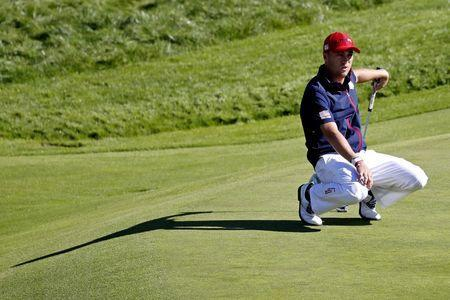 FILE PHOTO: Sep 30, 2018; Paris, FRA; United States golfer Justin Thomas reacts to his putt on the ninth green during the Sunday singles matches at Le Golf National. Mandatory Credit: Brian Spurlock-USA TODAY Sports/File Photo