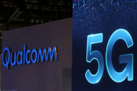 1e1cc737258 FILE PHOTO: Qualcomm and 5G logos are seen at the Mobile World Congress in  Barcelona