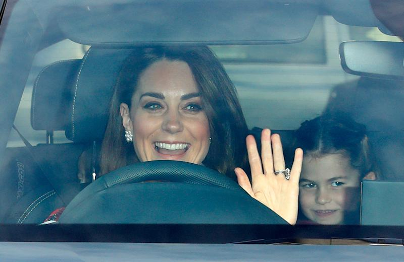 The Duchess of Cambridge gives a wave as she drives Princess Charlotte and Prince Louis to the Queen's Christmas lunch at Buckingham Palace Buckingham Palace on December 18, 2019 in London, England.
