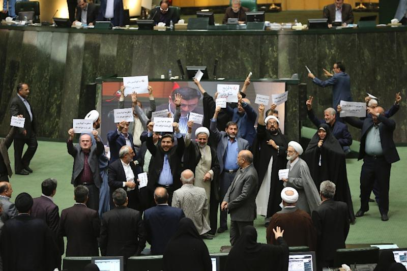 Iranian MPs show their disagreement over a bill on countering terrorist financing in parliament on October 7, 2018