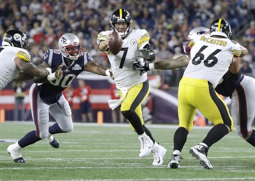 Pittsburgh Steelers quarterback Ben Roethlisberger (7) tries to scramble away from New England Patriots linebacker Shilique Calhoun (90) in the second half of an NFL football game, Sunday, Sept. 8, 2019, in Foxborough, Mass. (AP Photo/Steven Senne)