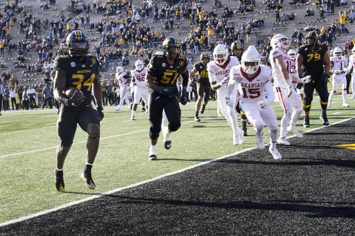 Missouri running back Larry Rountree III (34) scores during the second half of an NCAA college football game against Arkansas Saturday, Dec. 5, 2020, in Columbia, Mo. (AP Photo/L.G. Patterson)