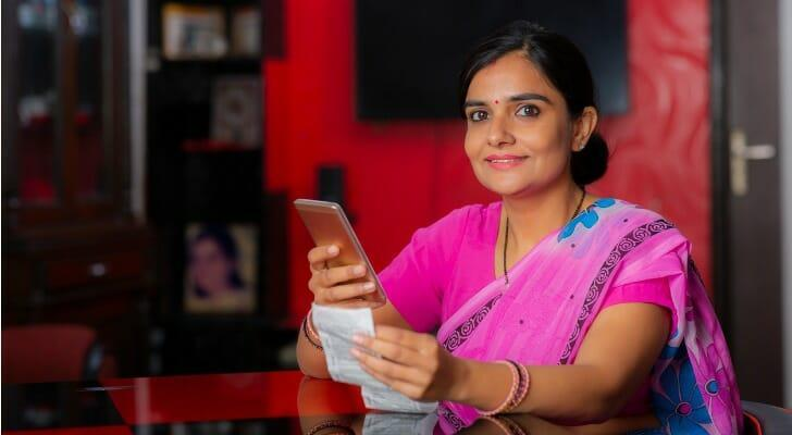Indian woman checking her dividend payout