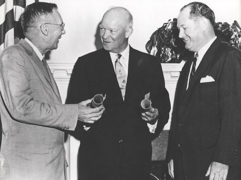 This undated image provided by NASA shows President Dwight Eisenhower, center, commissioning Dr. T. Keith Glennan, right, as the first administrator for NASA and Dr. Hugh L. Dryden as deputy administrator, in Washington, D.C. A bill in Congress wants to rename the NASA Dryden Flight Research Center in Southern California after Neil Armstrong, the Apollo 11 astronaut to honor his time there as a test pilot. (AP Photo/NASA)