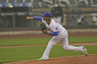 New York Mets starting pitcher Marcus Stroman throws in the rain against the Miami Marlins during the first inning of a baseball game at Citi Field, Sunday, April 11, 2021, in New York. The game was delayed at the top of the first inning due to rain. (AP Photo/Seth Wenig)