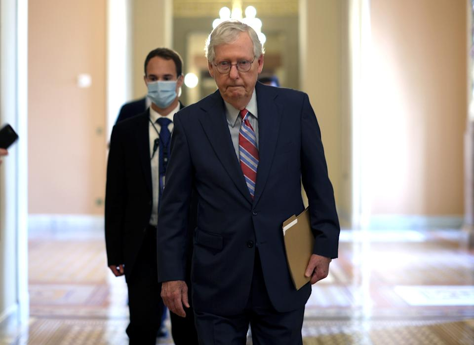 WASHINGTON, DC - SEPTEMBER 14: Senate Minority Leader Mitch McConnell (R-KY) walks to the Senate Chambers at the U.S. Capitol on September 14, 2021 in Washington, DC. Congress is working on a final passage of the $3.5 trillion reconciliation package. (Photo by Kevin Dietsch/Getty Images)