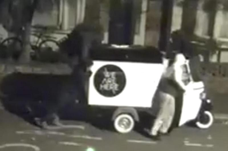 The men first appeared to try and push the tuk tuk away