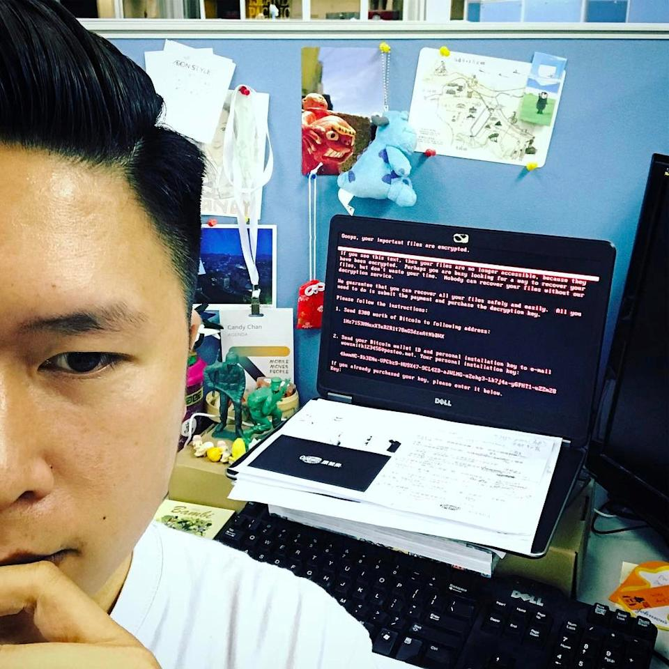 A user takes a selfie in front of a laptop at WPP, a British multinational advertising and public relations company in Hong Kong, China June 28, 2017 in this picture obtained from social media. INSTAGRAM/KENNYMIMO via REUTERS  THIS IMAGE HAS BEEN SUPPLIED BY A THIRD PARTY.  NO RESALES. NO ARCHIVES. MANDATORY CREDIT