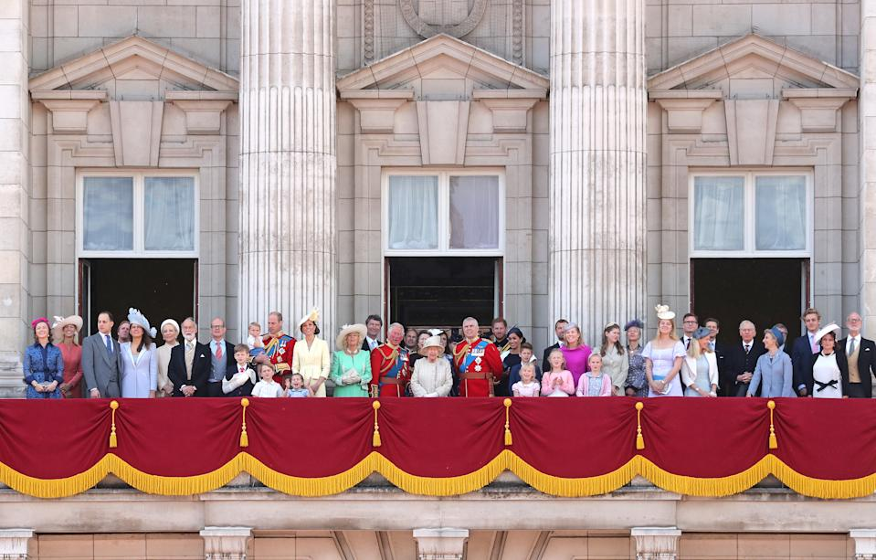 Albert Windsor, Prince William, holding Prince Louis, Prince George, Princess Charlotte, Duchess of Cambridge, Duchess of Cornwall, Vice Admiral Timothy Laurence, Prince Charles, Princess Beatrice of York, Princess Anne, Queen Elizabeth II, Princess Eugenie of York, Lady Louise Windsor, Prince Andrew, Prince Harry, Duchess of Sussex, Isla Phillips, James, Viscount Severn, Savannah Phillips, Peter Phillips, Autumn Phillips, Lyla Gilman, Eloise Taylor and Lady Helen Taylor stand with other members of the Royal Family on the balcony of Buckingham Palace. (Getty Images)