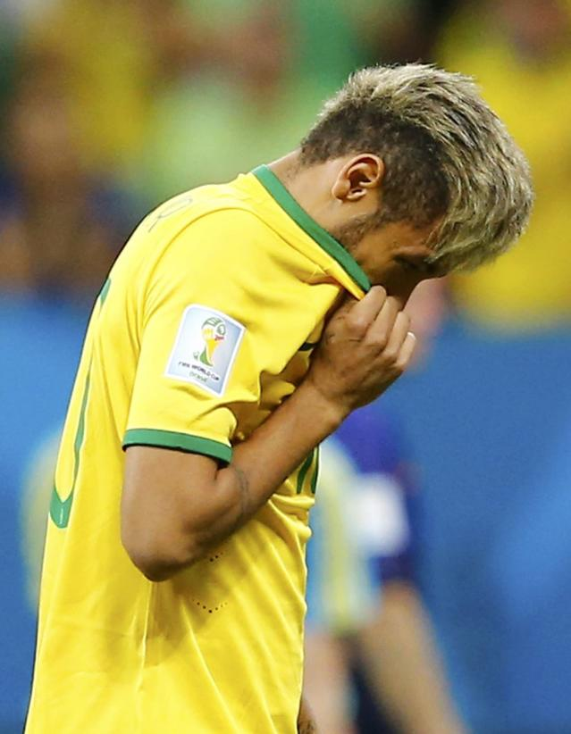 Brazil's Neymar reacts after his team lost their 2014 World Cup third-place playoff against the Netherlands at the Brasilia national stadium in Brasilia July 12, 2014. REUTERS/Dominic Ebenbichler (BRAZIL - Tags: SOCCER SPORT WORLD CUP)