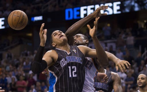 Orlando Magic's Tobias Harris (12) fights for a rebound with Oklahoma City Thunder's Serge Ibaka during the second half of an NBA basketball game on Friday, March 22, 2013, in Orlando, Fla. The Thunder won 97-89. (AP Photo/Willie J. Allen Jr.)