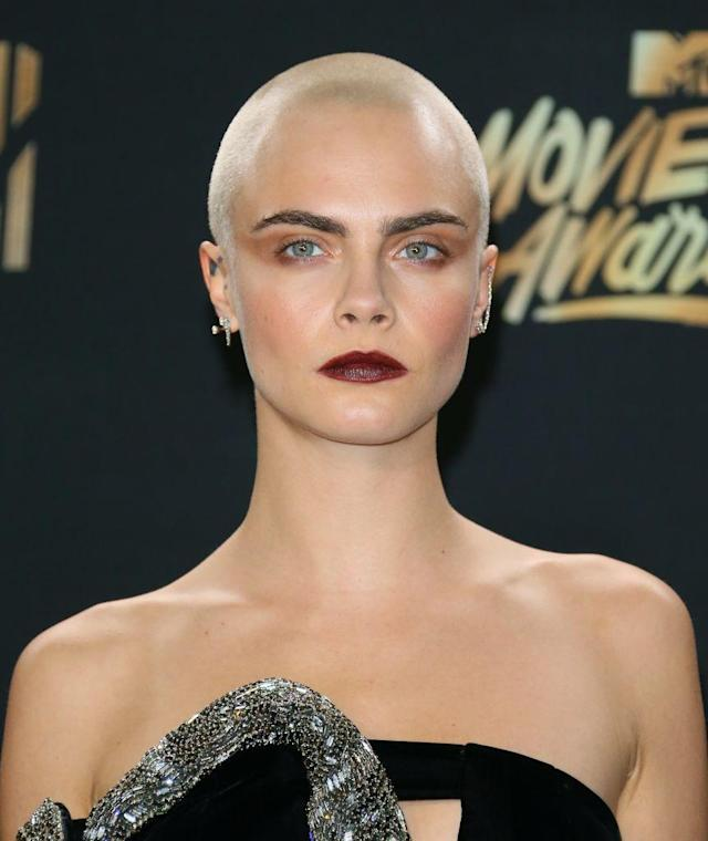 <p>Delevingne debuted her shaved head in April, while filming for <em>Life in a Year</em>. The feature, in which the model and actress is playing a young woman dying of cancer, is set to be released in 2018. (Photo: Getty Images) </p>