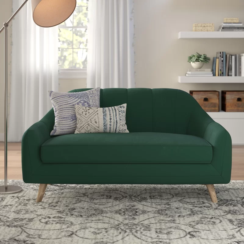 """<h2>64% Off Mistana Boevange-Sur-Attert Velvet Flared Arm Loveseat</h2><br><strong>213 reviews and 4.7 out of 5 stars</strong><br>""""Lucious and handy! Beautiful workmanship. A little jewel. Goes so well in our small living room. Ordered another just like it!"""" <em>– Wayfair Reviewer</em><br><br><em>Shop <strong><a href=""""https://www.wayfair.com/furniture/pdp/mistana-boevange-sur-attert-575-velvet-flared-arm-loveseat-mitn1901.html"""" rel=""""nofollow noopener"""" target=""""_blank"""" data-ylk=""""slk:Wayfair"""" class=""""link rapid-noclick-resp"""">Wayfair</a></strong></em><br><br><strong>Mistana</strong> Boevange-sur-Attert 57.5"""" Velvet Flared Arm Loveseat, $, available at <a href=""""https://go.skimresources.com/?id=30283X879131&url=https%3A%2F%2Fwww.wayfair.com%2Ffurniture%2Fpdp%2Fmistana-boevange-sur-attert-575-velvet-flared-arm-loveseat-mitn1901.html"""" rel=""""nofollow noopener"""" target=""""_blank"""" data-ylk=""""slk:Wayfair"""" class=""""link rapid-noclick-resp"""">Wayfair</a>"""
