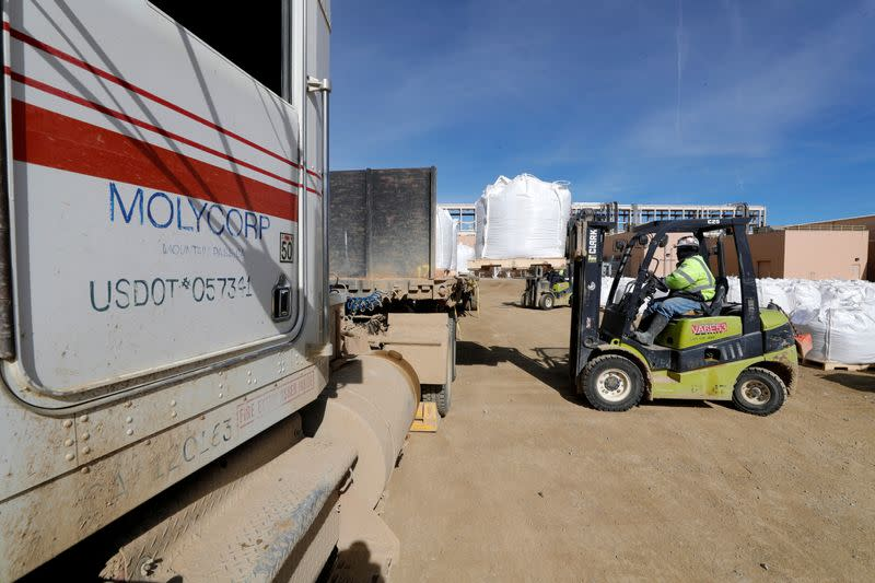 FILE PHOTO: A forklift operator arranges 1,500 kg bags of bastnasite concentrate for shipping at the MP Materials, formerly Molycorp, rare earth mine in Mountain Pass
