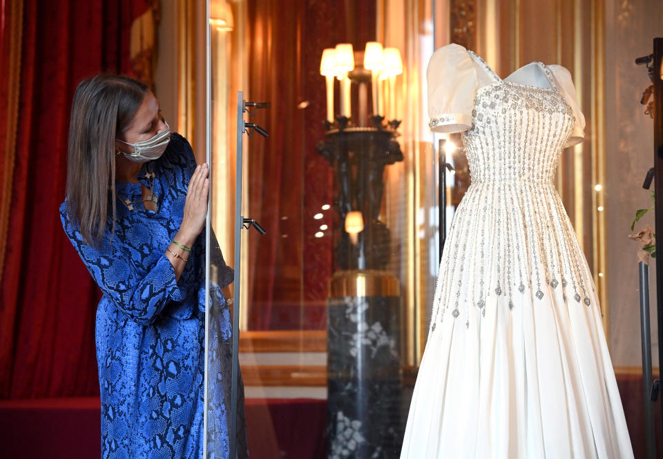 WINDSOR, ENGLAND - SEPTEMBER 23: Royal Collection Trust Curator Caroline de Guitut views HRH Princess Beatrice of York's wedding dress on display at Windsor Castle on September 23, 2020 in Windsor, England. Princess Beatrice and Edoardo Mapelli Mozzi married on July 18, 2020 in Windsor. The wedding dress, first worn by Her Majesty The Queen in the 1960s, will go on public display at Windsor Castle from Thursday, 24 September 2020. (Photo by Karwai Tang/WireImage)