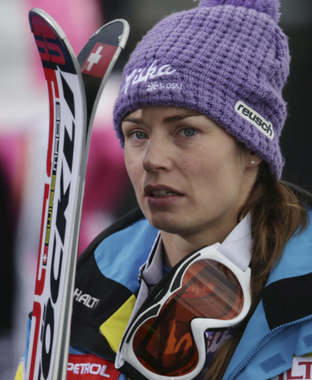 Slovenia's Tina Maze reacts after learning that United States' Lindsey Vonn crashed during the women's super-G at the Alpine skiing world championships in Schladming, Austria, Tuesday, Feb.5,2013. (AP Photo/Matthias Schrader)