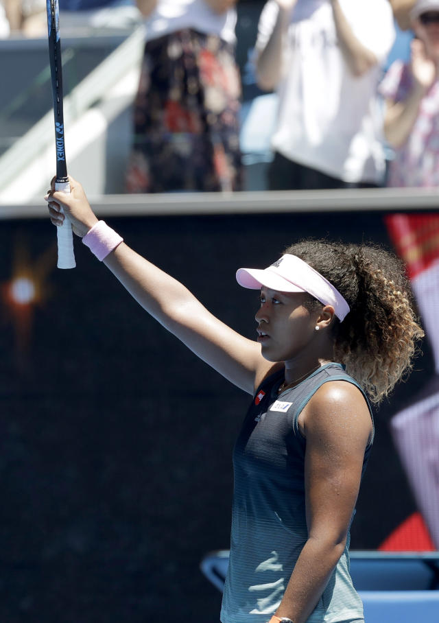Japan's Naomi Osaka reacts after defeating Taiwan's Hsieh Su-Wei during their third round match at the Australian Open tennis championships in Melbourne, Australia, Saturday, Jan. 19, 2019. (AP Photo/Kin Cheung)