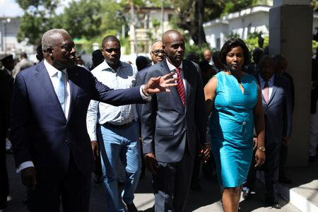 Haitian Defence Minister Herve Denis, President Jovenel Moise and First Lady Martine visit the Defense Ministry during the establishment ceremony of the Joint Chiefs of Staff of the Haitian Armed Forces (FAD'H) in Port-au-Prince, Haiti, March 27, 2018. REUTERS/Andres Martinez Casares