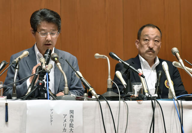 Kwansei Gakuin head coach Hideaki Toriuchi, right, and the team football director Hiromu Ono attend a press conference in Nishinomiya, western Japan Thursday May 17, 2018. The head coach of Nihon University football team has denied instructing his players to commit fouls against opponents after footage of a controversial tackle went viral. In the video played widely on Japanese television, a Kwansei Gakuin quarterback is blindsided with a late hit by a Nihon University player in the May 6 game. (Keiji Uesyo/Kyodo News via AP)