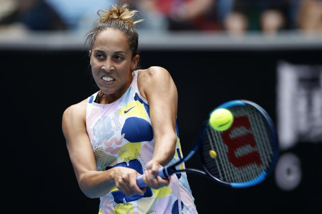 Madison Keys of the U.S. returns a backhand return to Greece's Maria Sakkari in their third round singles match at the Australian Open tennis championship in Melbourne, Australia, Friday, Jan. 24, 2020. (AP Photo/Andy Wong)