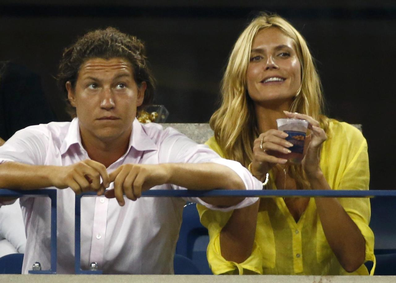 "Heidi Klum and boyfriend Vito Schnabel are reportedly ""happier than ever"" despite recent reports that the art curator was photographed allegedly kissing another woman. Pictured: Klum sits next to Schnabel as they watch the men's singles match between Milos Raonic of Canada and Kei Nishikori of Japan at the 2014 U.S. Open tennis tournament in New York on Sept. 1, 2014."