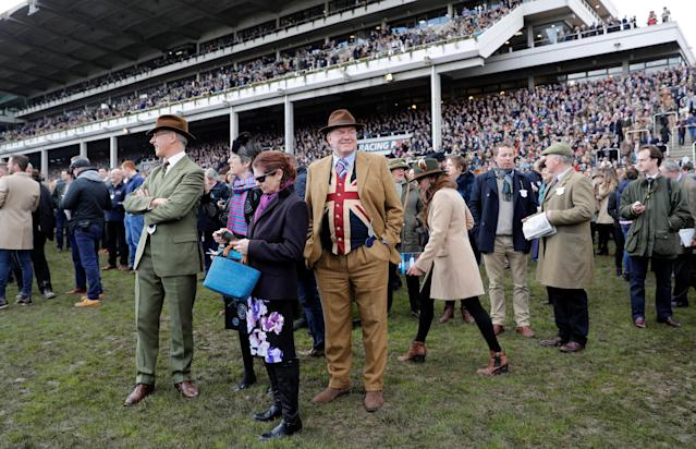 Horse Racing - Cheltenham Festival - Cheltenham Racecourse, Cheltenham, Britain - March 13, 2018 Racegoers look on before the 13:30 Sky Bet Supreme Novices' Hurdle REUTERS/Darren Staples