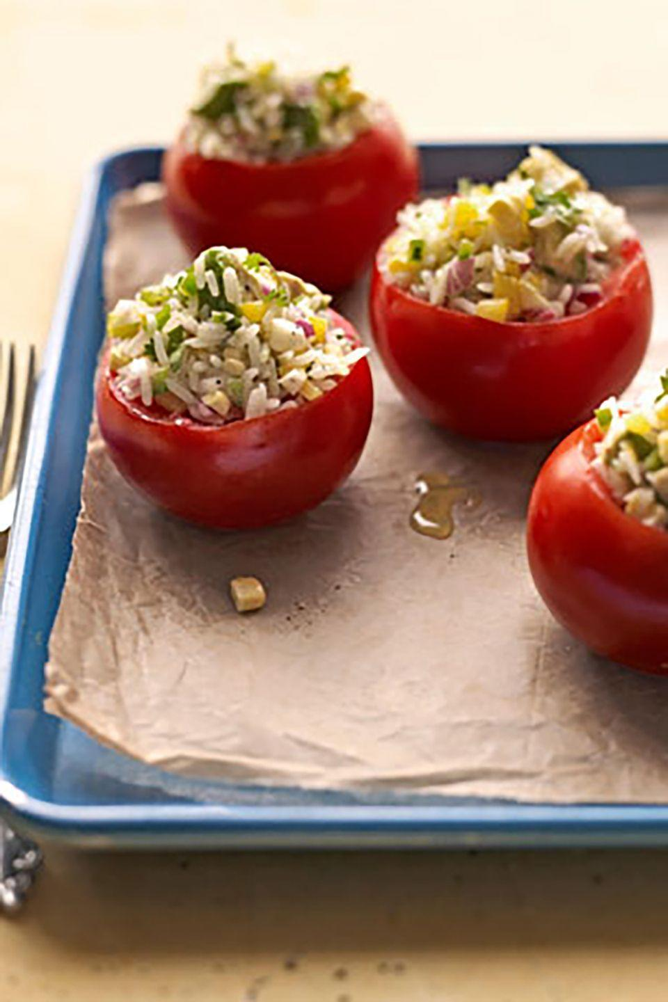 "<p>Take advantage of the fresh tastes by stuffing vine tomatoes with corn, avocado, and cilantro.</p><p><strong><a href=""https://www.countryliving.com/food-drinks/recipes/a2907/corn-stuffed-tomatoes-recipe/"" rel=""nofollow noopener"" target=""_blank"" data-ylk=""slk:Get the recipe"" class=""link rapid-noclick-resp"">Get the recipe</a>.</strong></p>"