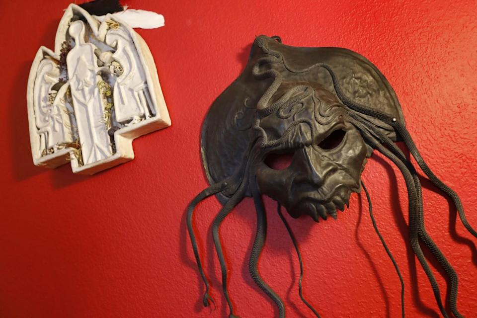 A variety of altars, masks and other meaningful items.