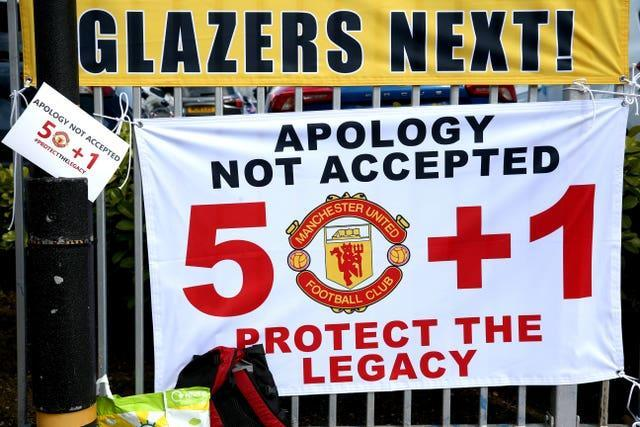 Banners near the stadium as fans protest against the Glazer family