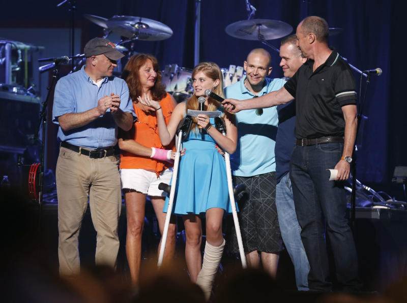 Boston Marathon bombing victim CVictoria McGrath, 20, center, thanks people who help her when she was injured and help her recovery during the Boston Strong Concert: An Evening of Support and Celebration at the TD Garden on Thursday, May 30, 2013 in Boston. (Photo by Bizuayehu Tesfaye/Invision/AP)