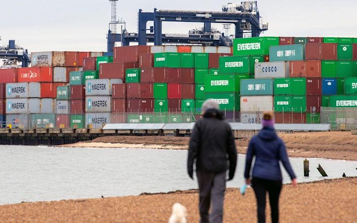 Shipping containers are unloaded from a cargo ship at the Port of Felixstowe in Suffolk. Shipments of personal protective equipment have been clogging UK ports, causing huge delays compounded by retailers and manufacturers importing goods for the Christmas shopping rush. PA Photo. Picture date: Sunday December 13, 2020. The UK's busiest port is struggling to deal with the congestion as other businesses are bringing in items before the end of the Brexit transition period on December 31, when customs checks with the European Union are expected to cause even more delays. See PA story POLITICS Brexit. Photo credit should read: Joe Giddens/PA Wire - Joe Giddens/PA Wire/Joe Giddens/PA Wire