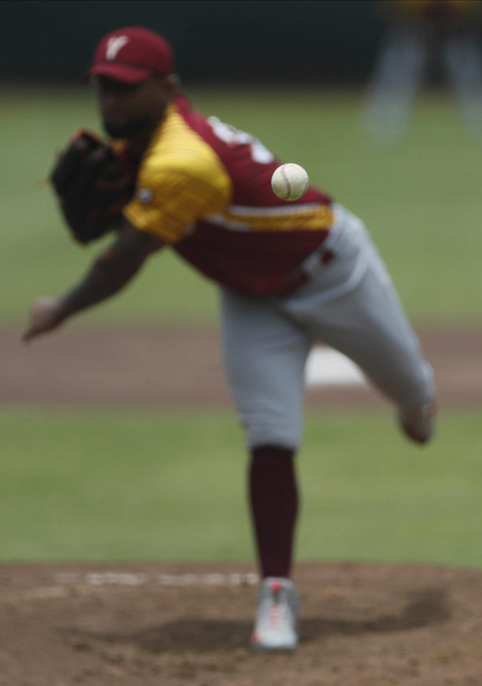 Venezuela pitcher Yapson Gomez delivers a pitch during a final Olympic baseball qualifier game against the Dominican Republic, in Puebla, Mexico, Saturday, June 26, 2021. (AP Photo/Fernando Llano)