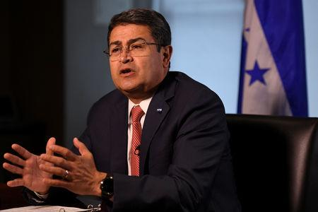 Honduran President Juan Orlando Hernandez speaks during an interview with Reuters on the sidelines of the United Nations General Assembly in New York City