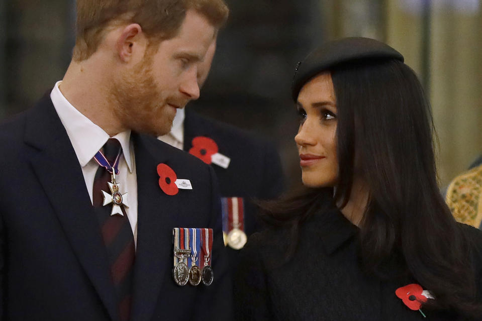 TOPSHOT - Britain's Prince Harry (L) and his US fiancee Meghan Markle attend a service of commemoration and thanksgiving to mark Anzac Day in Westminster Abbey in London on April 25, 2018. - Anzac Day marks the anniversary of the first major military action fought by Australian and New Zealand forces during the First World War. The Australian and New Zealand Army Corps (ANZAC) landed at Gallipoli in Turkey during World War I. (Photo by Kirsty Wigglesworth / POOL / AFP)        (Photo credit should read KIRSTY WIGGLESWORTH/AFP via Getty Images)