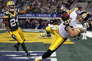 Hines Ward's eight-yard touchdown reception just before halftime cut the Packers' lead to 21-10