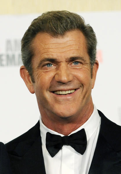 "FILE - In this Oct. 14, 2011 file photo, Mel Gibson poses at the 25th American Cinematheque Award benefit gala honoring actor Robert Downey Jr., in Beverly Hills, Calif. The future of a film about the ancient Jewish warrior Judah Maccabee, is uncertain after a disagreement between producer Gibson and screenwriter Joe Eszterhas. Warner Bros. spokesman Paul McGuire said Friday that the studio is ""analyzing what to do with the project."" (AP Photo/Chris Pizzello, File)"