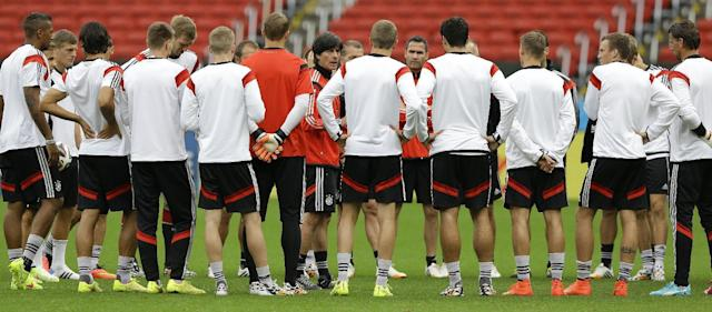 Germany's soccer team coach Joachim Loew , centre, speaks to his players during a training session at the Estadio Beira-Rio Stadium in Porto Alegre, Brazil, Sunday, June 29, 2014. Germany will play Algeria in a World Cup round of 16 soccer match on June 30. (AP Photo/Kirsty Wigglesworth)