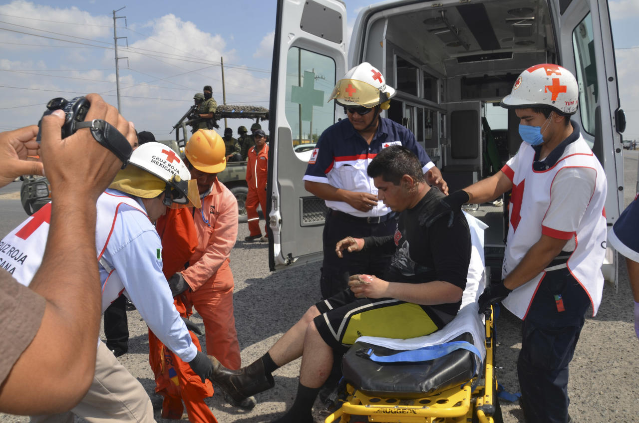 First responders treat a man after an explosion ripped through a gas pipeline distribution center in Reynosa, Mexico near Mexico's border with the United States, Tuesday Sept. 18, 2012. Mexico's state-owned oil company, Petroleos Mexicanos, also known as Pemex said the fire had been extinguished and the pipeline had been shut off but ten people were killed during the incident. (AP Photo/El Manana de Reynosa)