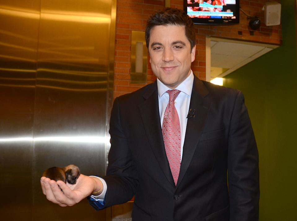 Josh Elliott holds a tiny Beyonce in the palm of his hand.