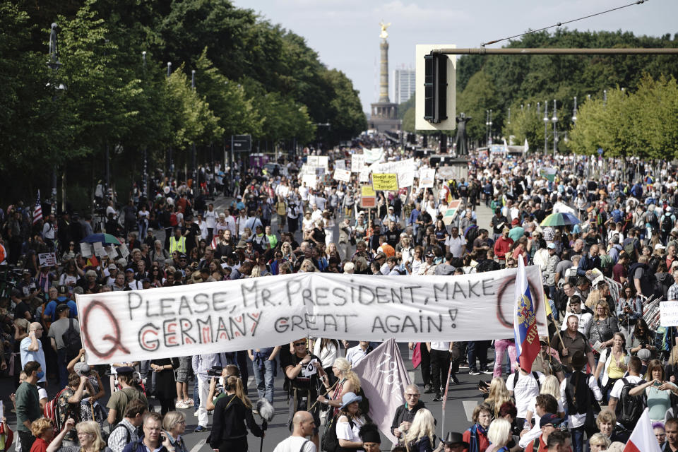 """Protestors hold a banner reading """"Please, Mr. President, Make Germany Great Again!"""" during demonstrations against the coronavirus measures by the German Government in Berlin, Germany, Saturday, Aug. 29, 2020. (Michael Kappeler/dpa via AP)"""