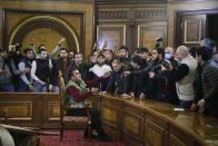 """Demonstrators argue as they broke into the government building protesting against an agreement to halt fighting over the Nagorno-Karabakh region, in Yerevan, Armenia, Tuesday, Nov. 10, 2020. Armenian Prime Minister Nikol Pashinian said on Facebook that calling an end to the fight was """"extremely painful for me personally and for our people."""" Soon after the announcement, thousands of people streamed to the main square in the Armenian capital Yerevan to protest the agreement, many shouting """"We won't give up our land."""" Some of them broke into the main government building, saying they were searching for Pashinian, who apparently had already departed. (AP Photo/Dmitri Lovetsky)"""