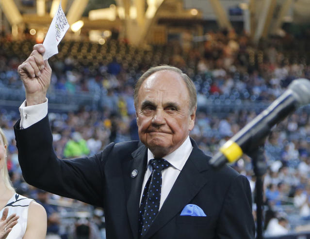 "FILE - In this Sept. 29, 2016, file photo, San Diego Padres broadcaster Dick Enberg waves to crowd at a retirement ceremony prior to the Padres' final home baseball game of the season, against the Los Angeles Dodgers in San Diego. Enberg replaced Curt Gowdy as the lead announce for NBC's coverage of the NFL in 1979 and spent more than three decades calling NFL games there and at CBS. Known for his exclamation ""Oh my!"" that was peppered throughout his broadcasts, Enberg called eight Super Bowls and NBC and was the pregame host for another. (AP Photo/Lenny Ignelzi, File)"