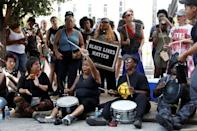 Protesters chant outside the courthouse after the not guilty verdict was announced in the murder trial of Jason Stockley, a former St. Louis police officer, charged with the 2011 shooting of Anthony Lamar Smith, in St. Louis, Missouri, U.S., September 15, 2017. REUTERS/Whitney Curtis/