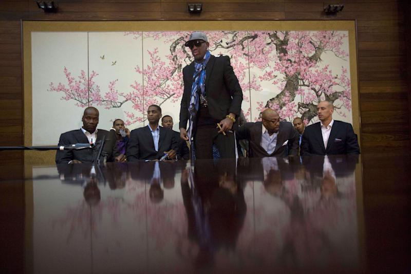 "Dennis Rodman stands up to leave after he and fellow US basketball players completed a television interview at a Pyongyang, North Korea hotel Tuesday, Jan. 7, 2014. Rodman came to the North Korean capital with a team of USA basketball stars for an exhibition game on Jan. 8, the birthday of North Korean leader Kim Jong Un. From left to right are Cliff Robinson, Jerry Dupree, Charles D. Smith, unidentified, Vin Baker, Andre ""Silk"" Poole and Doug Christie. (AP Photo/David Guttenfelder)"
