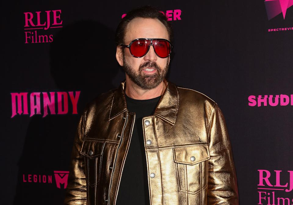 """Nicolas Cage's ex-girlfriend alleges that he abused her last month and that his estranged wife, Alice Kim Cage, has been stalking and harassing her. The Cages, who separated in 2016, deny the """"absurd"""" allegations. (Photo: Paul Archuleta/FilmMagic)"""
