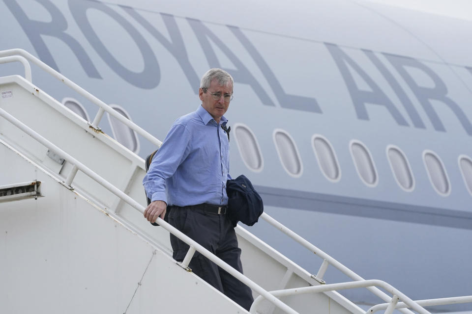 CAPTION CHANGES PHOTO SOURCE TO POOL Britain's ambassador to Afghanistan, Laurie Bristow after being evacuated from Kabul, Afghanistan, disembarks a plane upon its arrival at RAF Brize Norton base in Oxfordshire county, Britain, Sunday, Aug. 29, 2021. Military planes carrying British troops and diplomats from Kabul are landing at a U.K. air base after the U.K.'s two-week evacuation operation ended. The U.K. ambassador to Afghanistan, Laurie Bristow, was among those who arrived Sunday at RAF Brize Norton northwest of London, hours after the government announced that all British personnel had left Kabul. (Jonathan Brady/Pool Photo via AP)